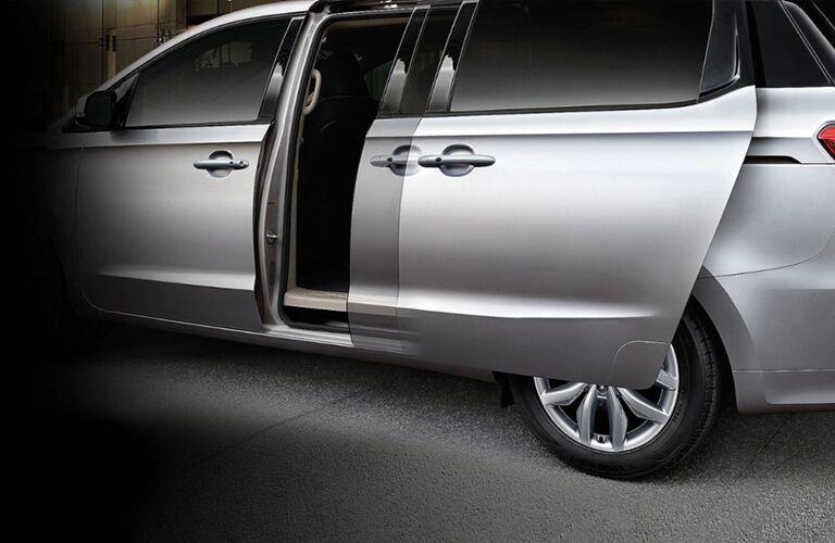 2021 Kia Sedona silver exterior driver side sliding rear door opening