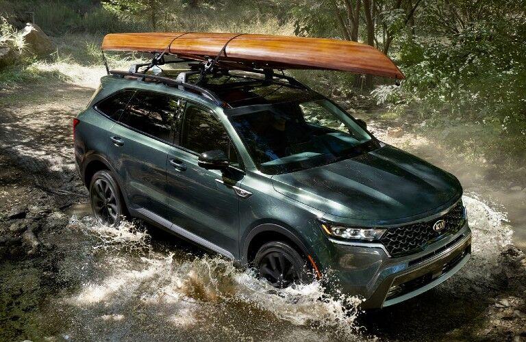 2021 Kia Sorento exterior front fascia passenger side kayak on roof driving through water