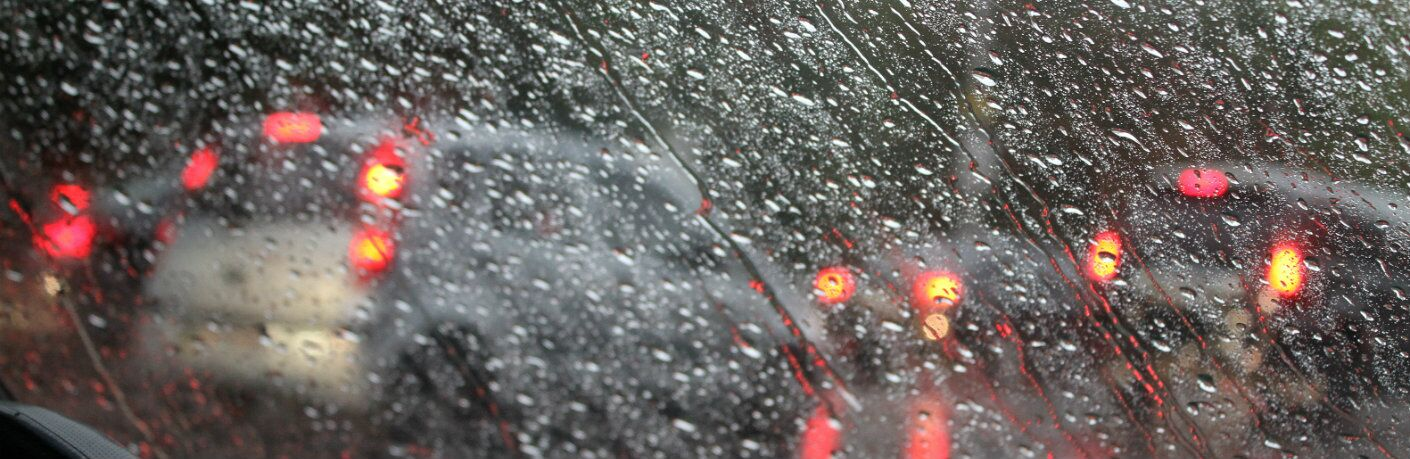 Windshield covered with raindrops