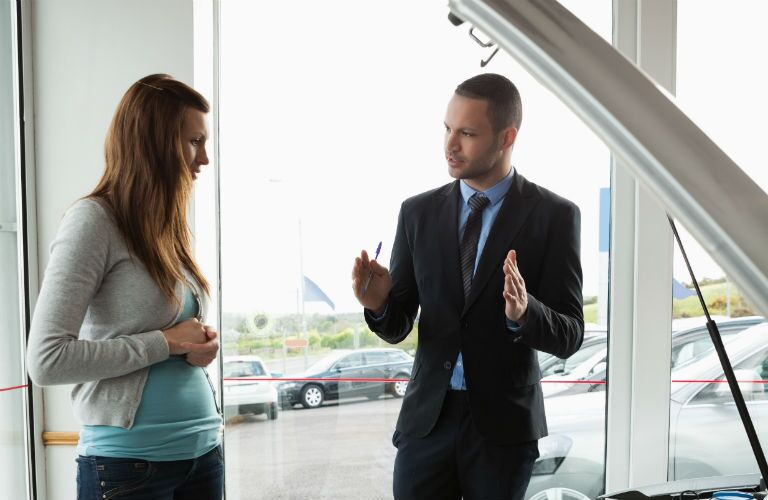 business man showing woman car_o