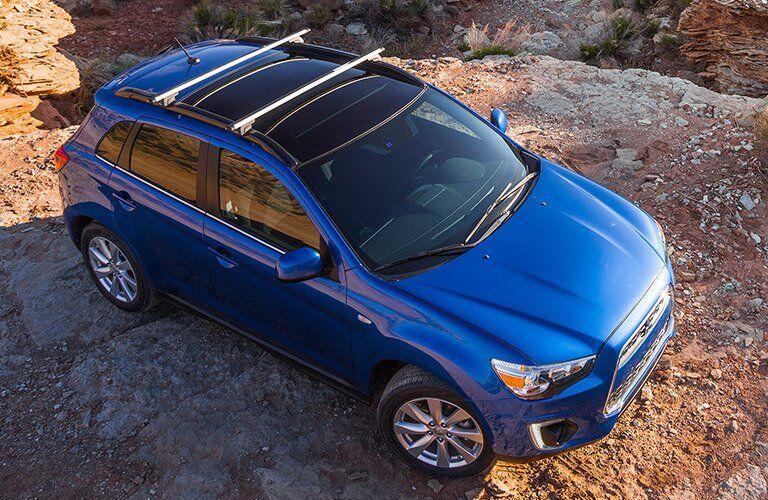 overhead view of the 2016 Mitsubishi Outlander Sport in blue on rocks