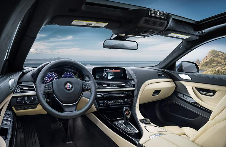 2017 BMW 6 Series Front Interior with Panoramic Sunroof, Steering Wheel and Touchscreen Display