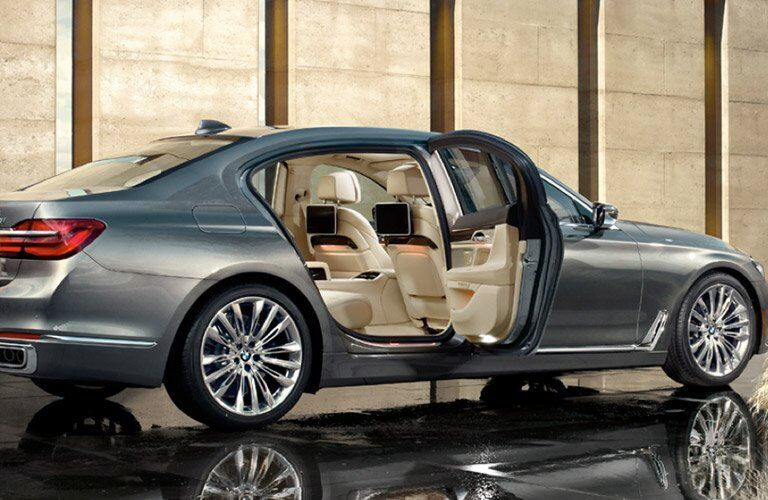 gray BMW 7 Series with doors open