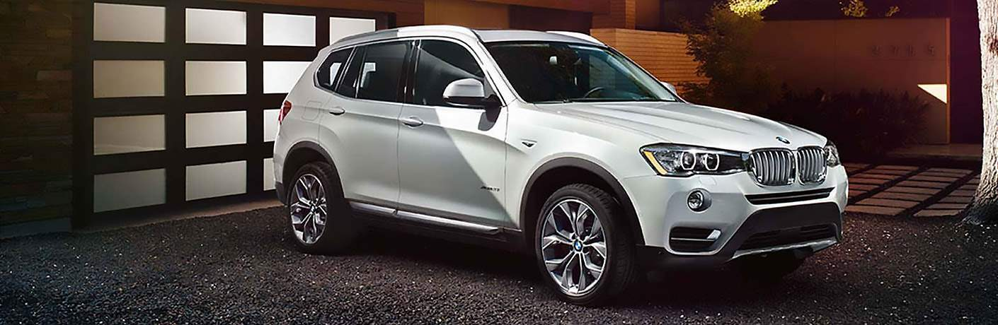 White 2017 BMW X3 Parked in Front of Garage