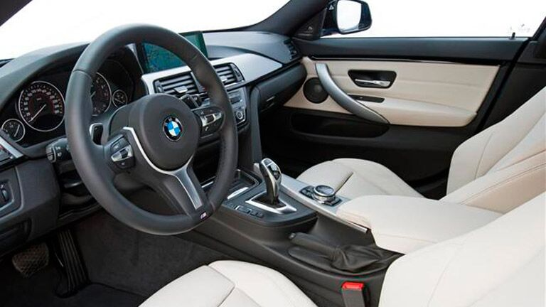2014 BMW 4 Series interior front cabin steering wheel dashboard and partial seats