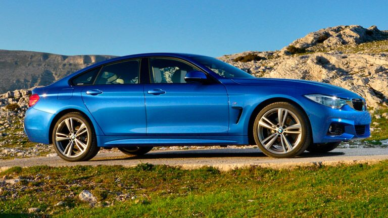 2014 BMW 4 Series exterior passenger side profile and partial front fascia