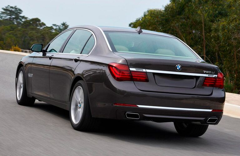 2014 BMW 7 Series exterior back fascia and drivers side on road