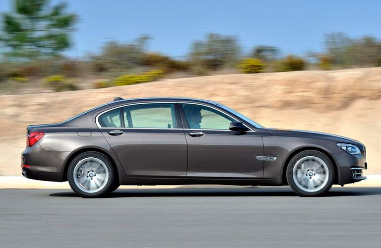 2014 BMW 7 Series exterior passenger side profile driving fast on road
