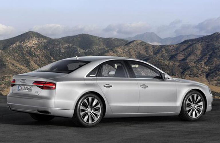 2015 Audi A8 exterior back fascia and passenger side parked in front of mountains