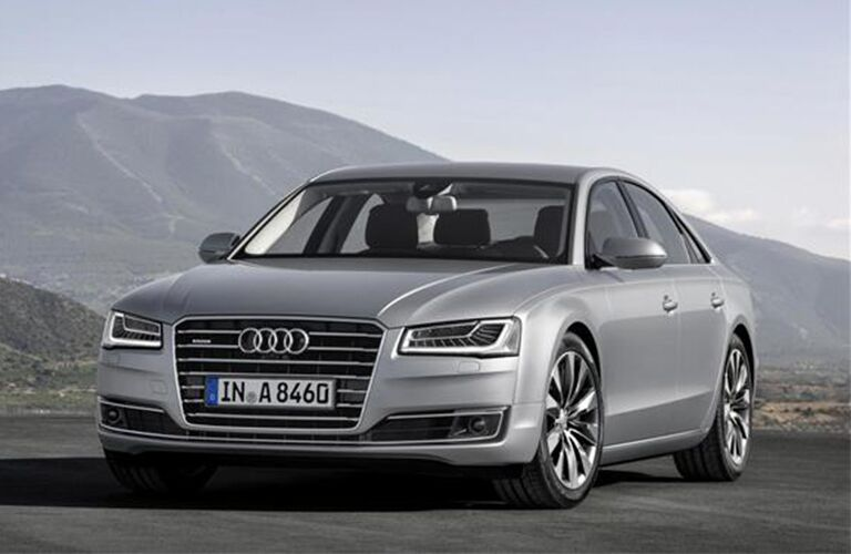 2015 Audi A8 exterior front fascia and drivers side parked in front of mountain