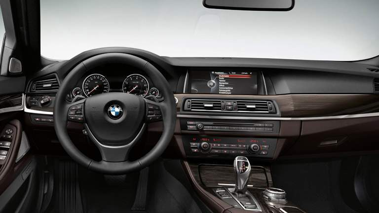 2015 BMW 5 Series interior front cabin steering wheel and dashboard