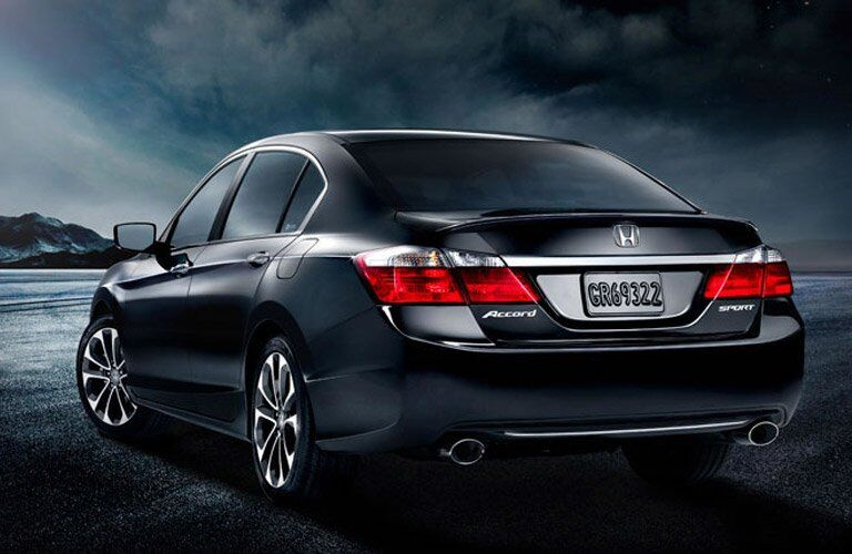 rear view of a 2015 Honda Accord, parked in front of a dark landscape