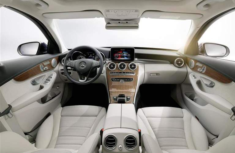 White 2015 Mercedes-Benz C-Class Front Seat Interior with view from backseat