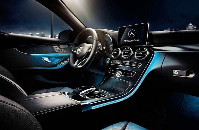 2015 Mercedes-Benz C-Class Front Seat Interior and Dashboard at Night with Blue Ambient Lighting