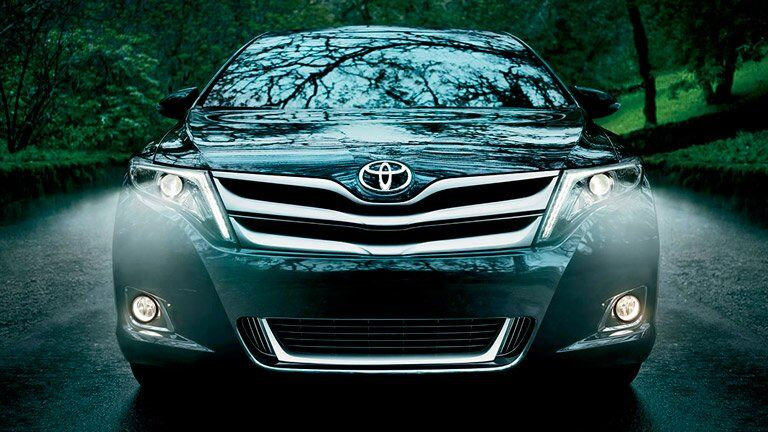 front grille view of the 2015 Toyota Venza driving through the woods