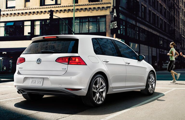 2015 VW Golf exterior back fascia and passenger side on street with joggers in front