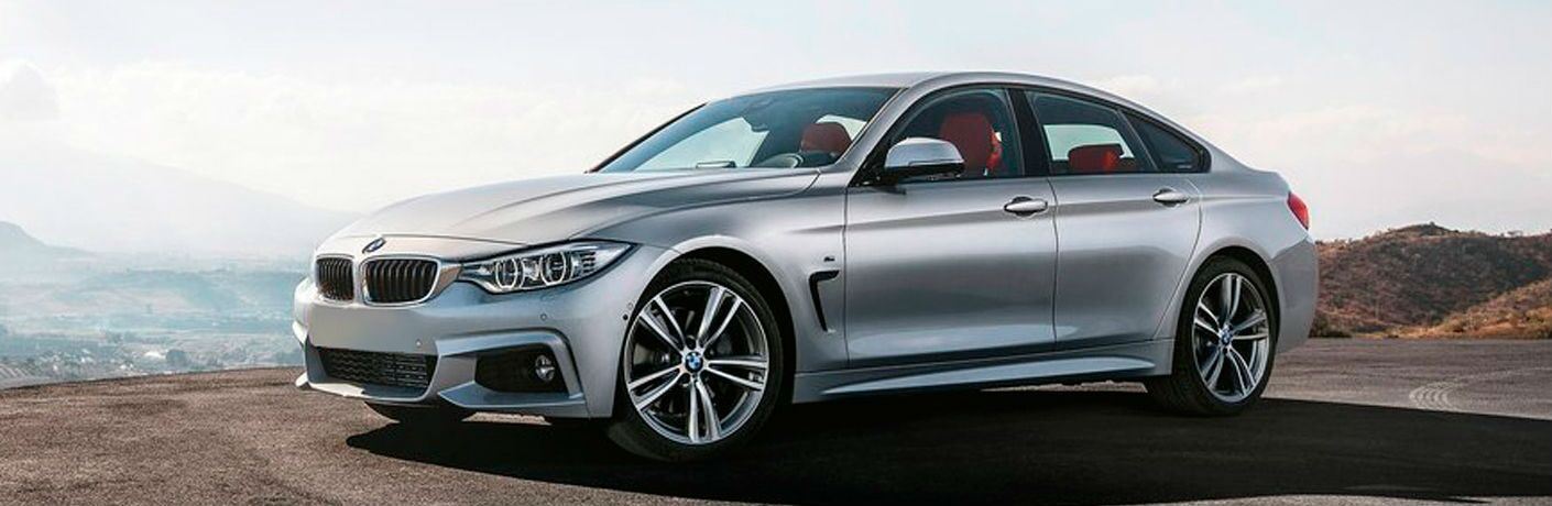 2015 BMW 4 Series exterior front fascia and drivers side on a cliff
