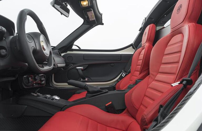 2016 Alfa Romeo interior front cabin side view of seats and steering wheel
