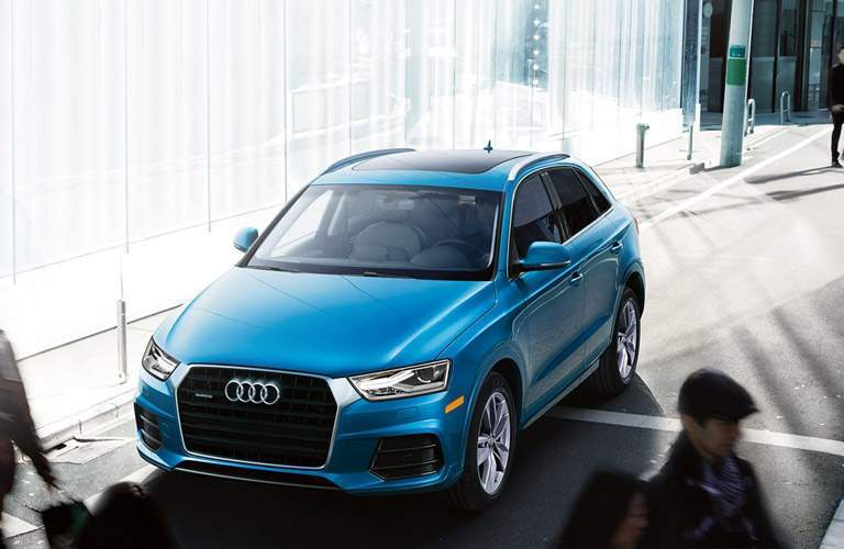 blue Audi Q3 front side view