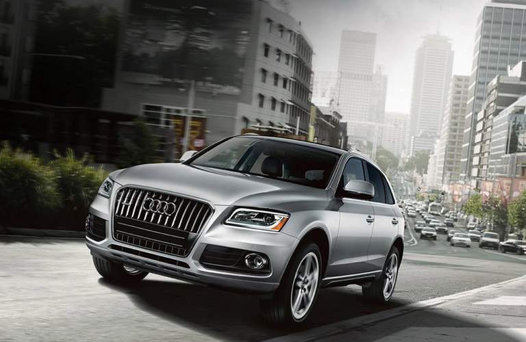 Silver 2016 Audi Q5 Front Exterior on Busy City Street