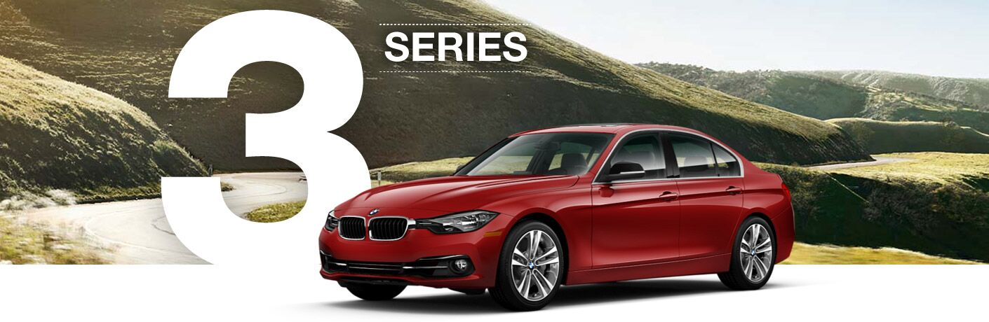 Red 2016 BMW 3 Series with Green Hills in Background and 3 Series Graphic