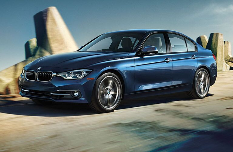 Blue 2016 BMW 3 Series in Front of Rocky Outcropping