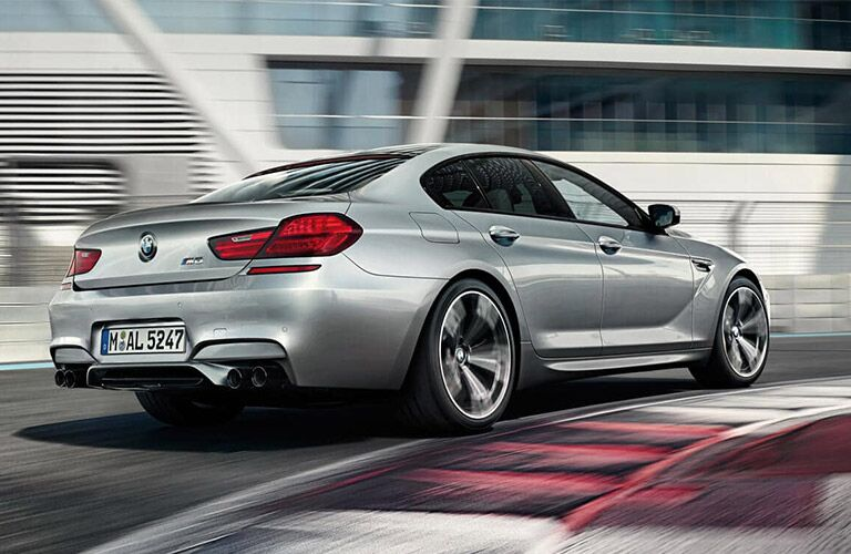 2016 BMW M6 exterior back fascia and passenger side on blurred road