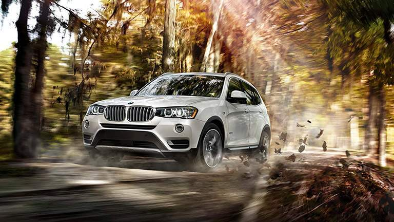 White 2016 BMW X3 Kicking Up Leaves on Wooded Trail