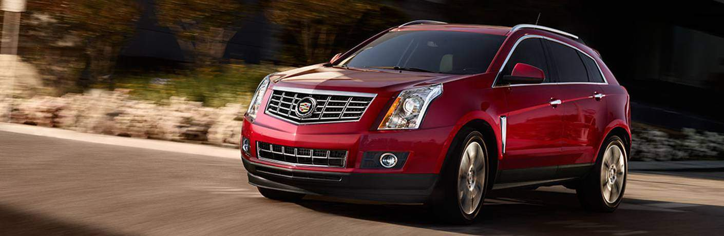 red Cadillac SRX front side view