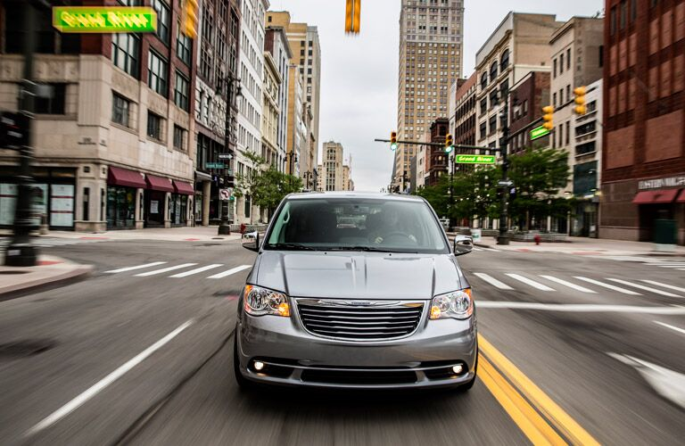 front view of the 2016 Chrysler Town & Country driving on the streets