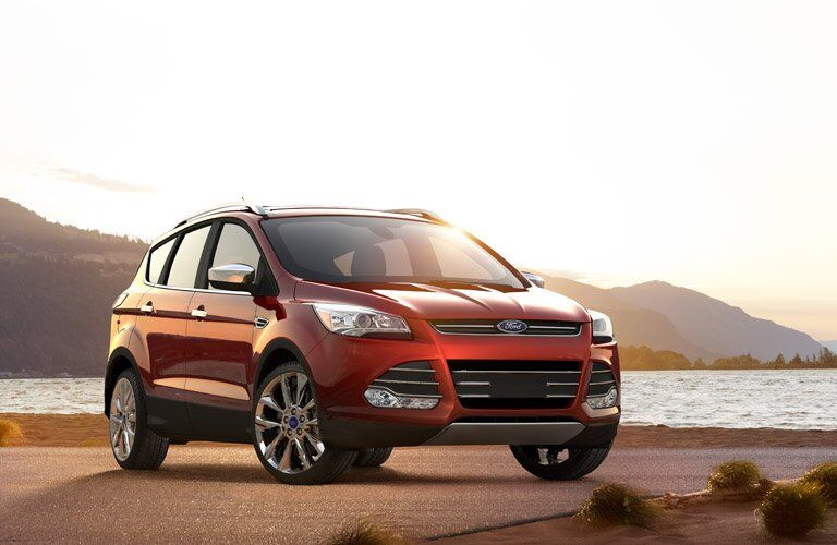 red 2016 Ford Escape parked in front of a lake