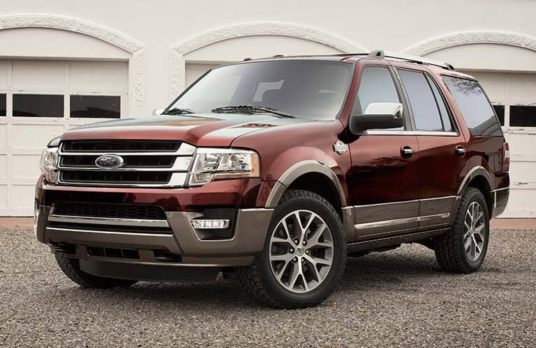 2016 Ford Expedition exterior front fascia and drivers side parked on gravel in front of garage