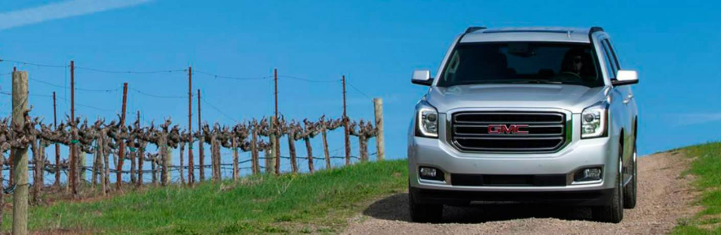 silver GMC Yukon front view