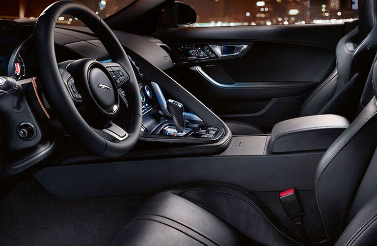 2016 Jaguar F-Type interior front cabin side view of steering wheel and dashboard partial seats