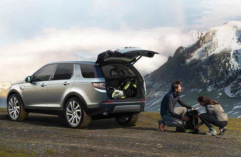 2016 Land Rover Discovery Sport Parked in Front of Mountains with Cargo Hatch Open
