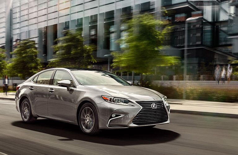 2016 Lexus ES exterior front fascia and passenger side going fast on city road