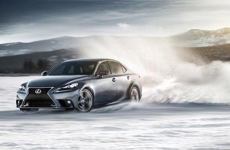 2017 Lexus IS driving boldly in the snow
