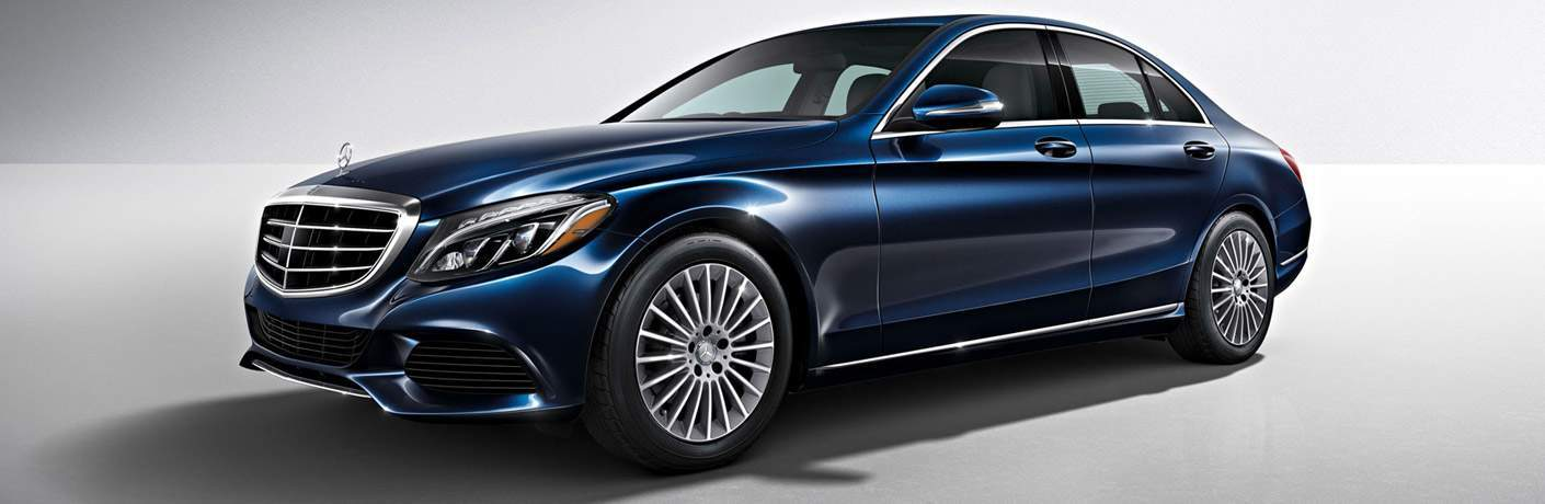 Blue 2016 Mercedes-Benz C-Class Sedan on Gray Background