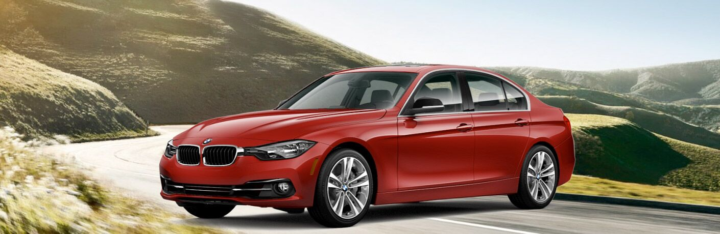 2017 BMW 3 Series exterior front fascia and drivers side parked on road with rolling hills