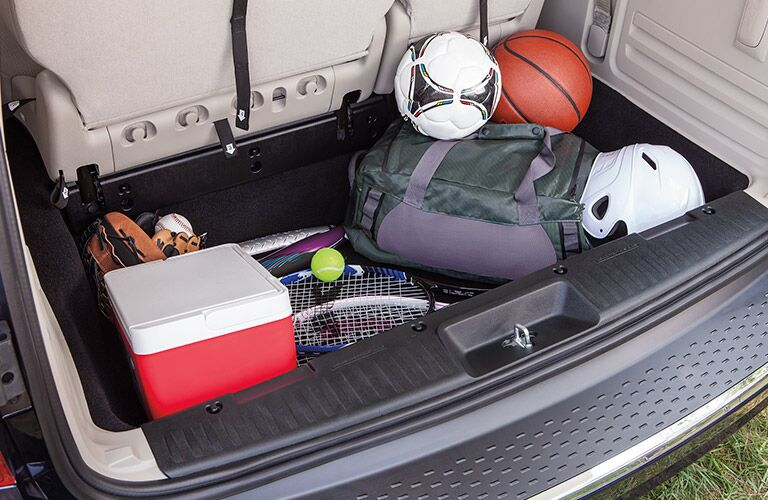 2017 Dodge Grand Caravan interior storage space in back cabin open with sporting things inside