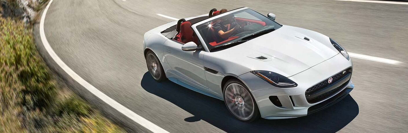 2017 Jaguar F-Type Convertible front fascia and passenger side going fast on road