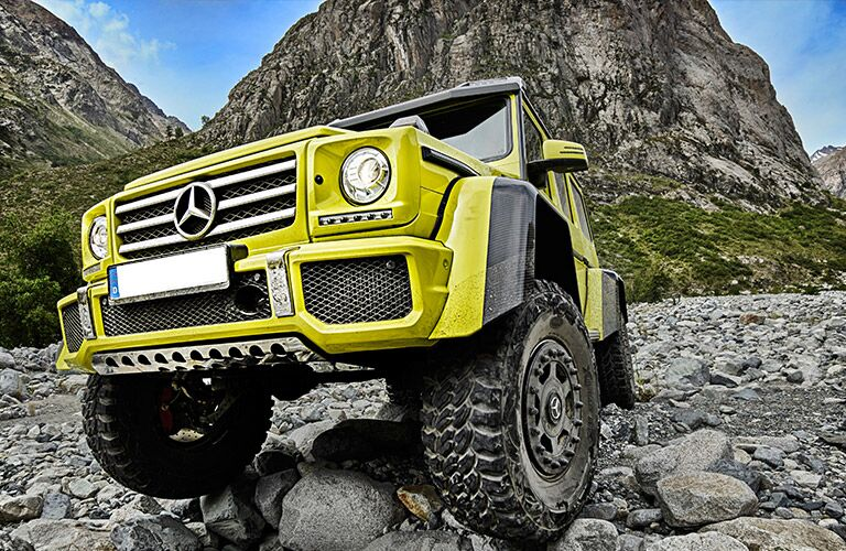 neon yellow Mercedes-Benz G550 driving off-road