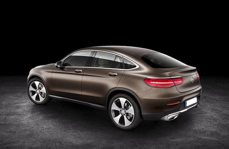 brown 2017 Mercedes-Benz GLC seen from the side against a black background