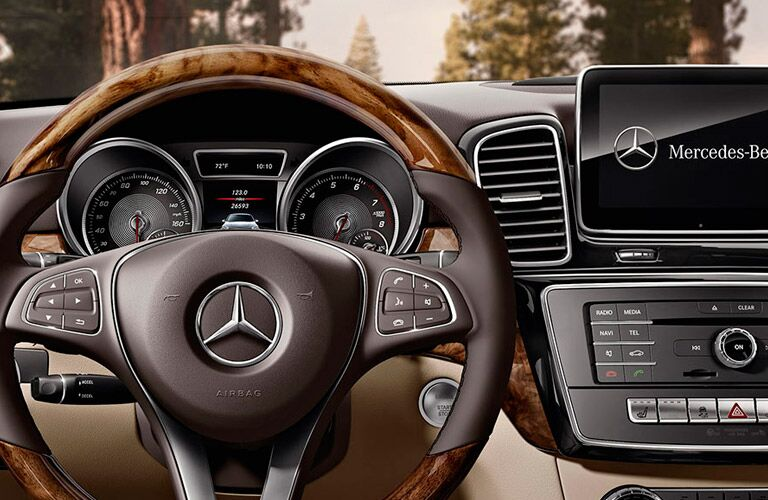 2017 Mercedes-Benz GLE350 interior front cabin close up of steering wheel and partial touchscreen
