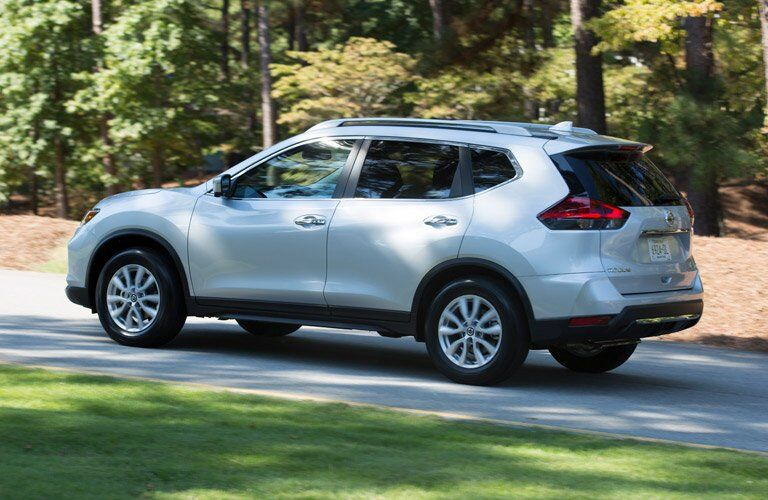 side view of a white 2017 Nissan Rogue