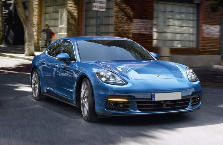 front view of the blue 2017 Porsche Panamera driving in the city