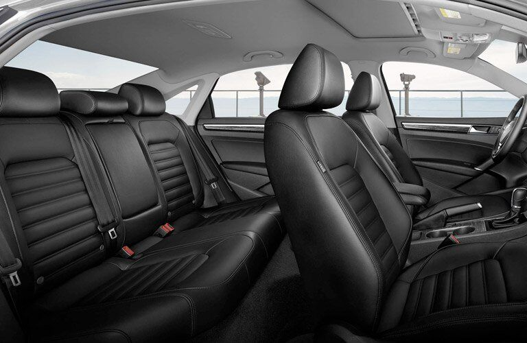 black front and rear seats of a 2017 Volkswagen Passat