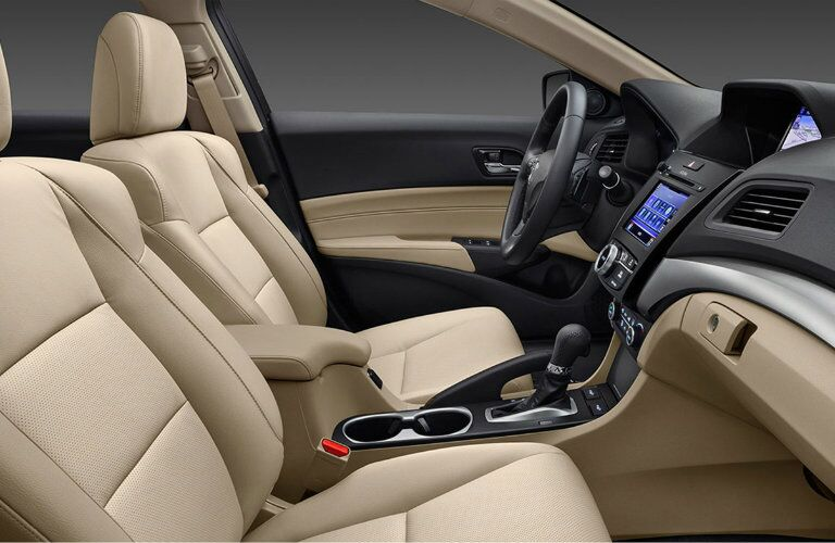 comfortable cream-colored front seats and dashboard of the Acura ILX