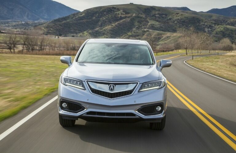 front view of a Acura RDX driving down a country road