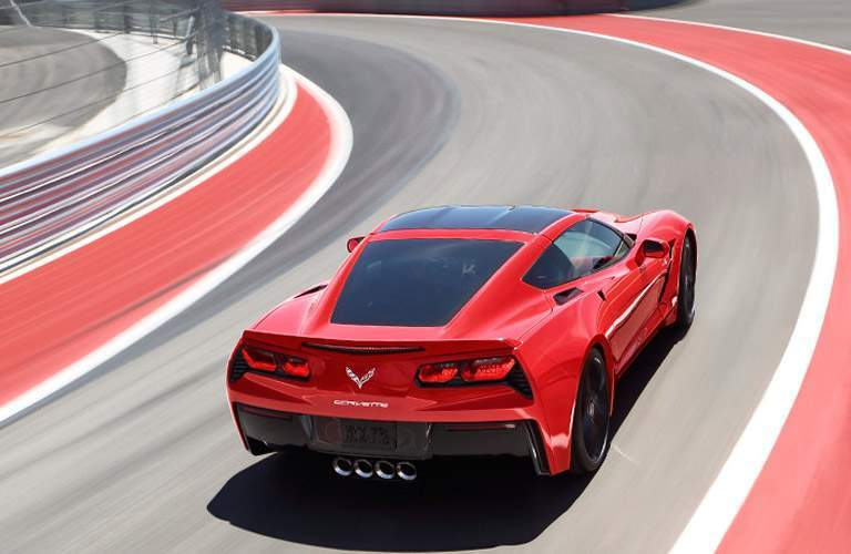rear view of the 2017 Chevy Corvette driving very fast on a track